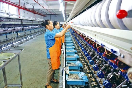 从江依托传统纺织产业优势带动村民就